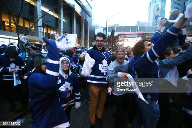 TORONTO ON APRIL 25 Toronto Maple Leafs fans outside cheer as the Leafs score Fans are watching the game on Bremner as all Toronto professional...