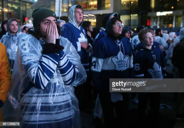 TORONTO ON APRIL 25 Toronto Maple Leafs fans outside react to a close play Fans are watching the game on Bremner as all Toronto professional sports...