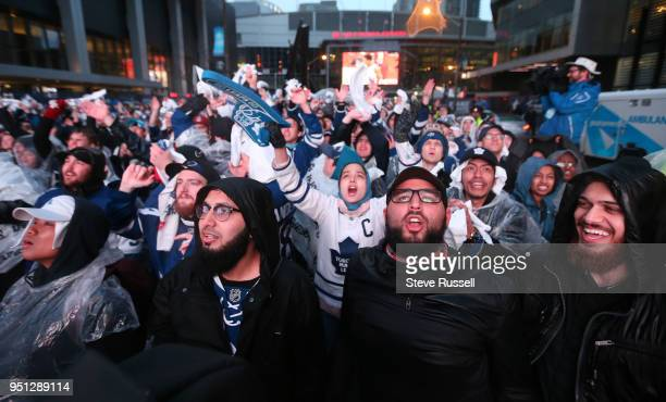 TORONTO ON APRIL 25 Toronto Maple Leafs fans watch the game on large screens Fans are watching the game on Bremner as all Toronto professional sports...