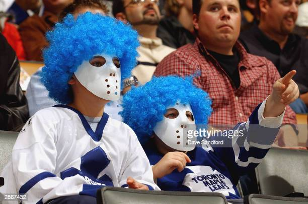 Toronto Maple Leafs fans wearing masks watch the action during the game against the Washington Capitals at Air Canada Centre on October 25 2003 in...