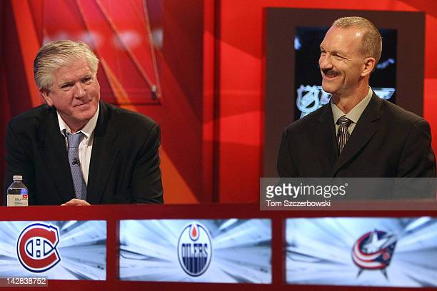 Toronto Maple Leafs General Manager Brian Burke talks with New York Islanders Director of Pro Scouting Ken Morrow before the start of the NHL Draft...