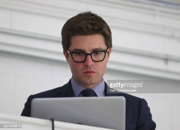 Toronto Maple Leafs general manager Kyle Dubas works on his laptop before the start of their pre-season game against the Ottawa Senators at Lucan...