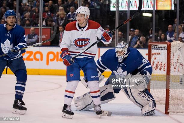 Toronto Maple Leafs Goalie Curtis McElhinney keeps an eye on the play behind Montreal Canadiens Right Wing Artturi Lehkonen during the regular season...