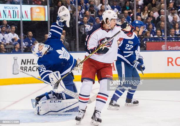Toronto Maple Leafs goalie Curtis McElhinney reacts after getting hit with a stick by Columbus Blue Jackets right wing Josh Anderson during the first...