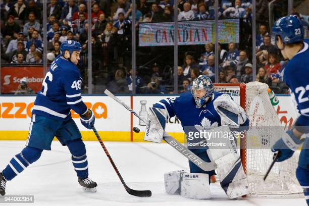 Toronto Maple Leafs Goalie Frederik Andersen and teammate Toronto Maple Leafs Defenceman Roman Polak try to contend with a shot on goal by Montreal...