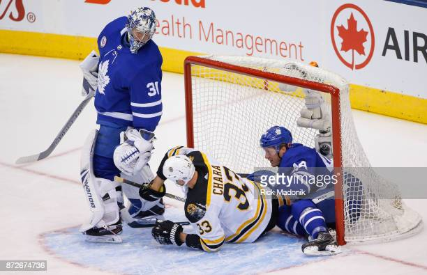 Toronto Maple Leafs goalie Frederik Andersen looks back to see Boston Bruins defenseman Zdeno Chara and Toronto Maple Leafs defenseman Morgan Rielly...
