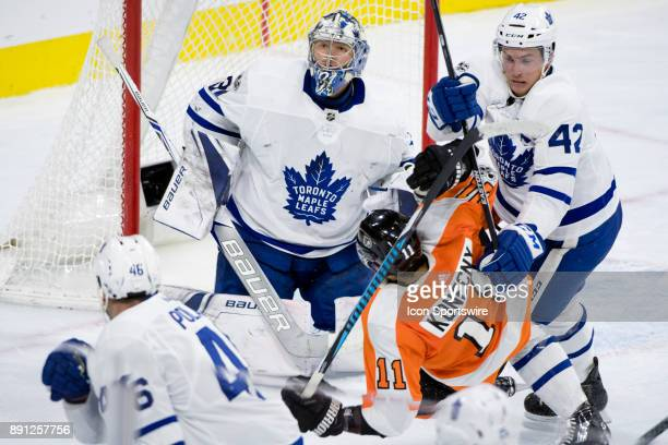 Toronto Maple Leafs Goalie Frederik Andersen looks up as Center Tyler Bozak checks Philadelphia Flyers Right Wing Travis Konecny in the third period...