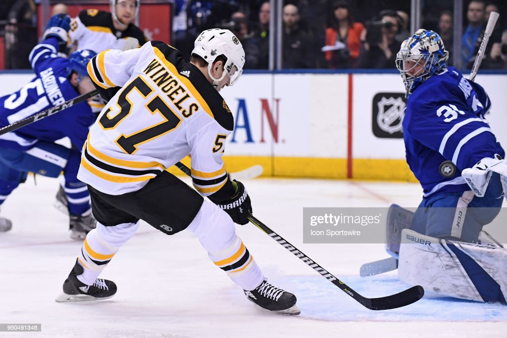 Toronto Maple Leafs Goalie Frederik Andersen (31) makes a save on Boston Bruins Forward Tommy Wingels (57) during the First Round NHL Playoff game between the Boston Bruins and Toronto Maple Leafs on April 23, 2018 at Air Canada Centre in Toronto, ON.