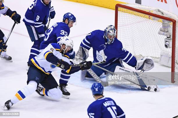 Toronto Maple Leafs Goalie Frederik Andersen makes a save on St Louis Blues Defenceman Joel Edmundson during the regular season NHL game between the...