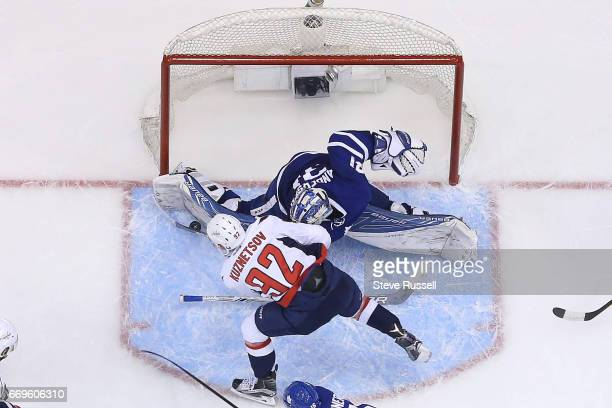 TORONTO ON APRIL 17 Toronto Maple Leafs goalie Frederik Andersen stops Washington Capitals center Evgeny Kuznetsov coming across the crease as the...