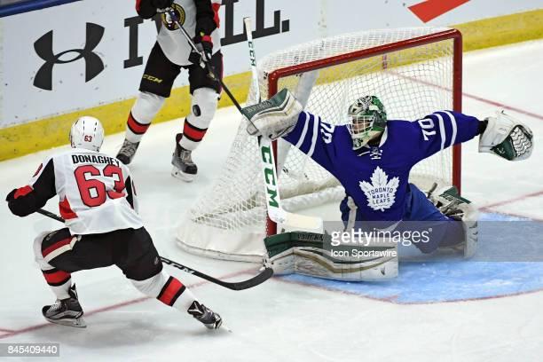 Toronto Maple Leafs Goalie Ian Scott makes a save on Ottawa Senators Defenceman Cody Donaghey during the NHL preseason Rookie Tournament game between...
