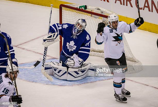 Toronto Maple Leafs goalie James Reimer reacts after giving up the first of two goals in the opening period as theToronto Maple Leafs take on the San...