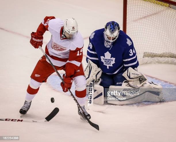 Toronto Maple Leafs goalie James Reimer stands his ground against Detroit Red Wings center Riley Sheahan as the Toronto Maple Leafs host the Detroit...