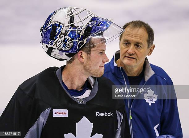 Toronto Maple Leafs goalie James Reimer talks with Goaltending coach Piero Greco, during practice at the Air Canada Centre in Toronto, October 7,...