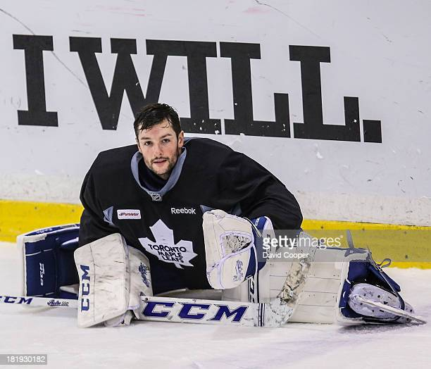 Toronto Maple Leafs goalie Jonathan Bernier stretches after workout at the MasterCard Centre for Hockey Excellence in Toronto, September 26, 2013.
