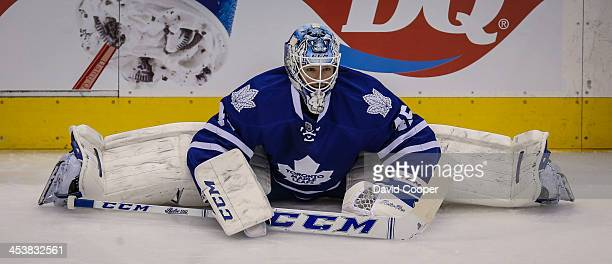 TORONTO ON DECEMBER 5 Toronto Maple Leafs goalie Jonathan Bernier stretches before the game between the Toronto Maple Leafs and the Dallas Stars at...