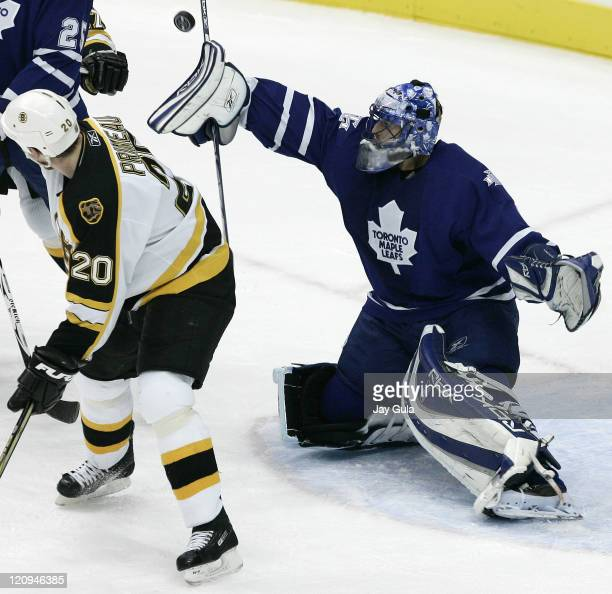 Toronto Maple Leafs goaltender Andrew Raycroft makes a blocker save as Boston's Wayne Primeau looks behind him for a rebound during game between the...