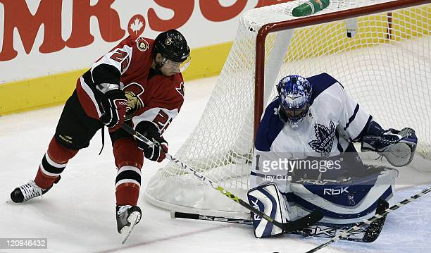 Toronto Maple Leafs goaltender Andrew Raycroft makes a save on Antoine Vermette of the Ottawa Senators in the NHL season opener at the Air Canada...