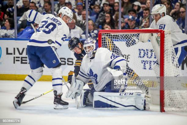 Toronto Maple Leafs goaltender Curtis McElhinney and Toronto Maple Leafs center William Nylander watch the puck fly in the air during an NHL game...