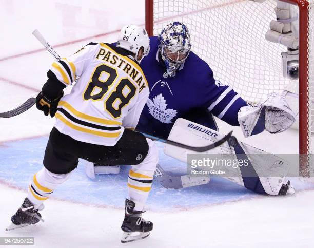 Toronto Maple Leafs goaltender Frederik Andersen makes a left pad save on a charging Boston Bruins right wing David Pastrnak late in the third period...