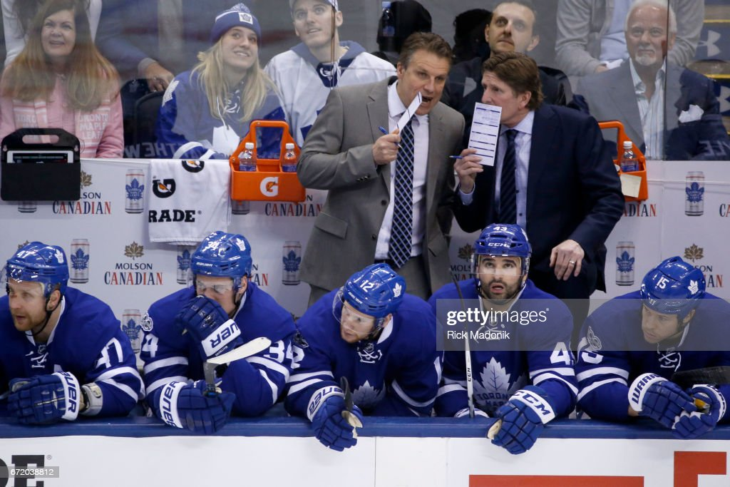 Toronto Maple Leafs head coach Mike Babcock and one of his coaching staff talk between plays. . Toronto Maple Leafs VS Washington Capitals during 1st period action in Game 6 of 1st round action of NHL playoffs at Air Canada Centre. Toronto Star/Rick Madonik