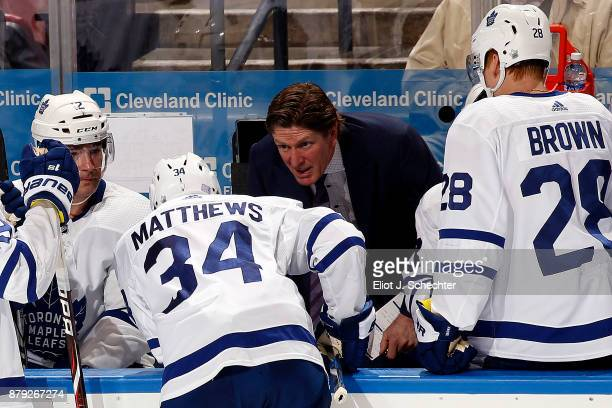 Toronto Maple Leafs Head Coach Mike Babcock chats with Auston Matthews during a break in the action against the Florida Panthers at the BBT Center on...
