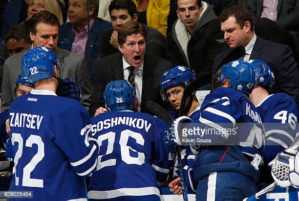 Toronto Maple Leafs head coach Mike Babcock directs his team during a time out during the third period against the Washington Capitals at the Air...