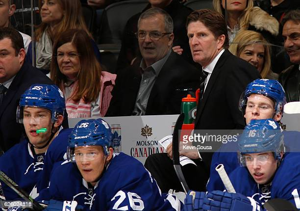 Toronto Maple Leafs head coach Mike Babcock follows the play against the Washington Capitals during the second period at the Air Canada Centre on...