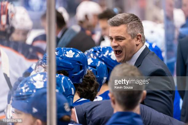 Toronto Maple Leafs head coach Sheldon Keefe looks on against the Edmonton Oilers from the bench during the second period at the Scotiabank Arena on...