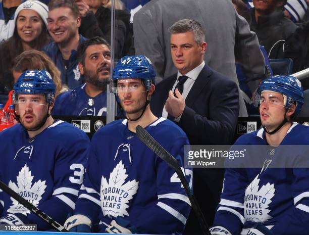 Toronto Maple Leafs Head Coach Sheldon Keefe watches the action from the bench during an NHL game against the Buffalo Sabres on November 29, 2019 at...