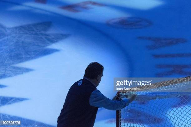 Toronto Maple Leafs ice crew member brings a net onto the ice before the regular season NHL game between the Vancouver Canucks and the Toronto Maple...