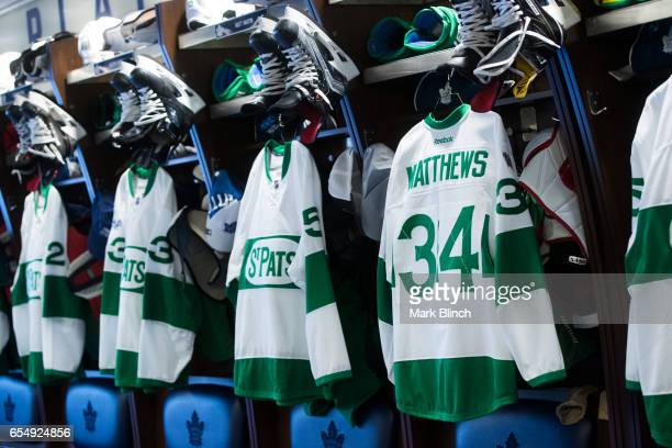 Toronto Maple Leafs jerseys including Auston Matthews with the St Pats logo hang in the dressing room prior to their game against the Chicago...