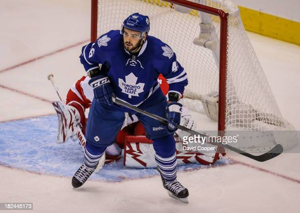 Toronto Maple Leafs left wing David Broll in front of the Red Wings net against Detroit Red Wings defenseman Xavier Ouellet ) during the game as the...