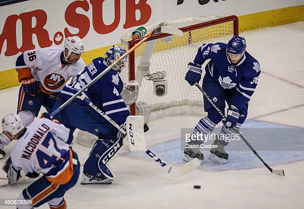 TORONTO ON NOVEMBER 19 Toronto Maple Leafs left wing Frazer McLaren plays goalie while Toronto Maple Leafs goalie Jonathan Bernier is caught out of...
