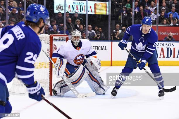 Toronto Maple Leafs Left Wing James van Riemsdyk awaits a pass from Toronto Maple Leafs Right Wing William Nylander infant of New York Islanders...