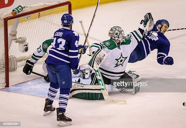 TORONTO ON DECEMBER 5 Toronto Maple Leafs left wing James van Riemsdyk gets knock of his feet in front of Dallas Stars goalie Kari Lehtonen drawning...