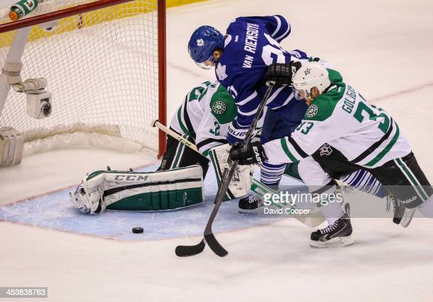Toronto Maple Leafs left wing James van Riemsdyk just fails to get his sick on the puck as Dallas Stars defenseman Alex Goligoski checks him in front...