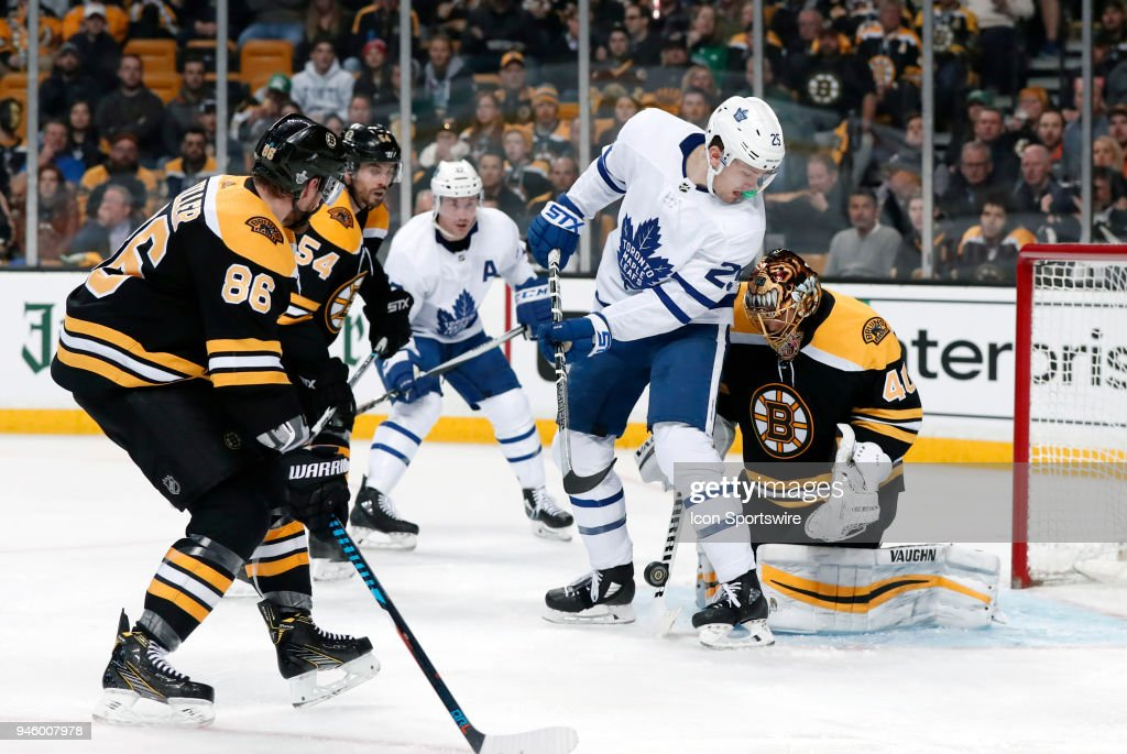 Toronto Maple Leafs left wing James van Riemsdyk (25) looks for the puck at his feet as Boston Bruins goalie Tuukka Rask (40) moves in during Game 1 of the First Round for the 2018 Stanley Cup Playoffs between the Boston Bruins and the Toronto Maple Leafs on April 12, 2018, at TD Garden in Boston, Massachusetts. The Bruins defeated the Maple Leafs 5-1.