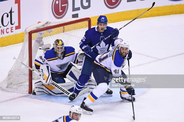 Toronto Maple Leafs Left Wing James van Riemsdyk screens St Louis Blues Goalie Carter Hutton as St Louis Blues Defenceman Robert Bortuzzo defends...