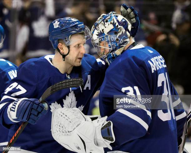 Toronto Maple Leafs Left Wing Leo Komarov congratulates teammate Goalie Frederik Andersen as the team celebrates its 42 win after the final NHL 2018...