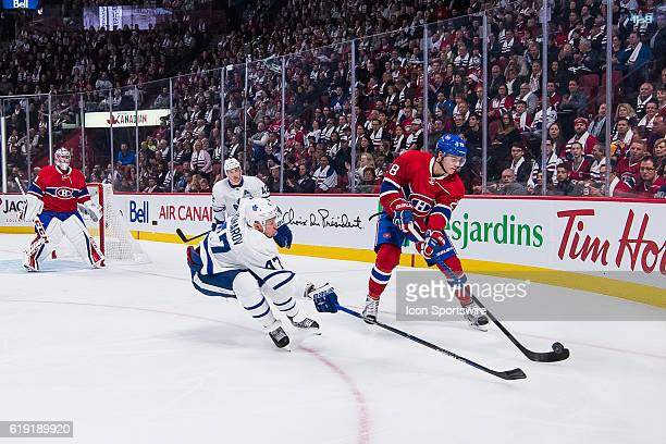 Toronto Maple Leafs Left Wing Leo Komarov trying to get the puck from Montreal Canadiens Defenceman Nathan Beaulieu during the Toronto Maple Leafs...