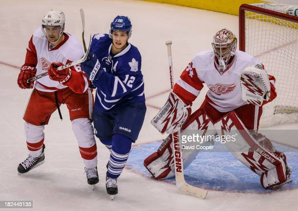 Toronto Maple Leafs left wing Mason Raymond in front of the Red Wings net against Detroit Red Wings defenseman Xavier Ouellet ) during the game as...