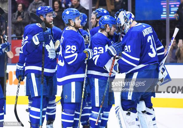 Toronto Maple Leafs left wing Tyler Ennis celebrates the win with Toronto Maple Leafs goaltender Frederik Andersen at the end of the third period in...