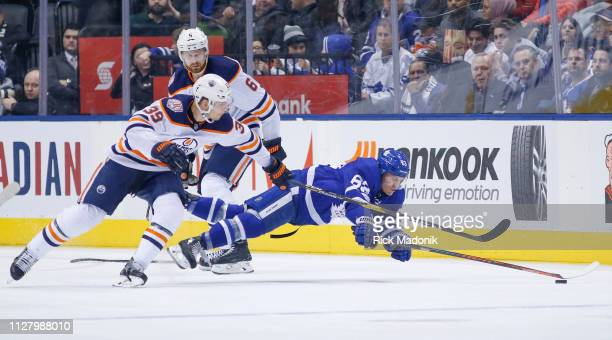 Toronto Maple Leafs left wing Tyler Ennis falls towards a loose puck as Edmonton Oilers right wing Alex Chiasson keeps close and Edmonton Oilers...