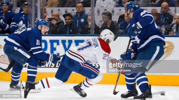 Toronto Maple Leafs Left Wing Zach Hyman checks Montreal Canadiens Winger Alex Galchenyuk as he try's top hold on to the puck during the final NHL...