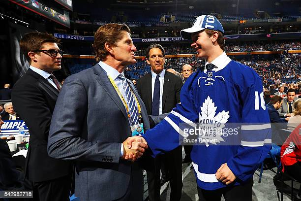 Toronto Maple Leafs Mike Babcock celebrates with Joesph Woll after being selected 62nd during the 2016 NHL Draft on June 25 2016 in Buffalo New York