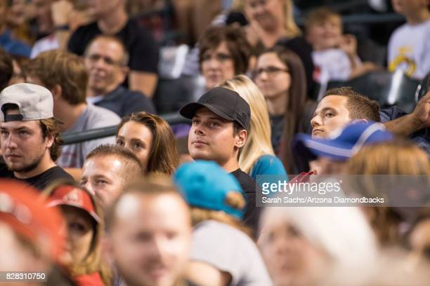 Toronto Maple Leafs player Auston Matthews watches an MLB game against the Arizona Diamondbacks and Los Angeles Dodgers at Chase Field on August 8...