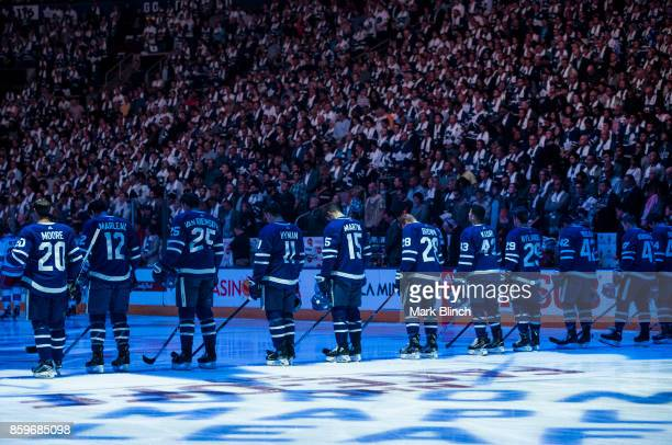 Toronto Maple Leafs players stand for a moment of silence for the victims of the Las Vegas and Edmonton attacks prior to the game against the New...