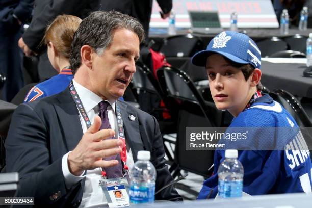 Toronto Maple Leafs president Brendan Shanahan and son Jack Shanahan sit on the floor during the 2017 NHL Draft at the United Center on June 23 2017...