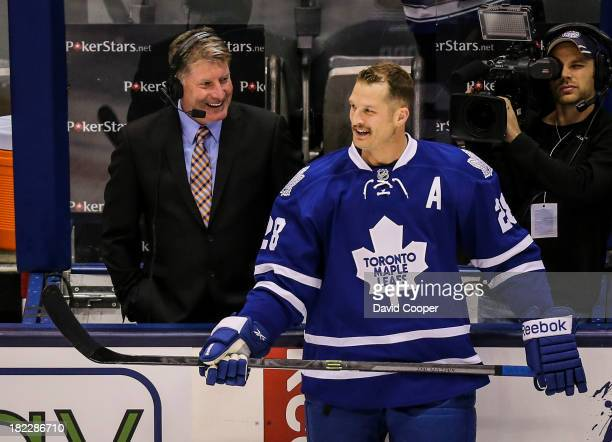 TORONTO ON SEPTEMBER 28 Toronto Maple Leafs right wing Colton Orr jokes with broadcaster and former goalie Glenn Healy during the warmup as the...